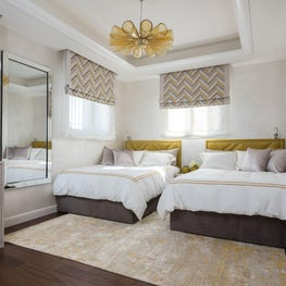 Bedroom with the just-right mustard yellow accents. Elegant and comfortable.