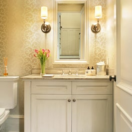 Powder room with custom vanity and wall covering