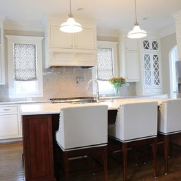 Custom window treatments and barstools.
