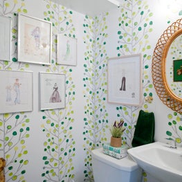 Guest Bathroom with costume sketches & wallpaper