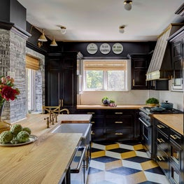 Black, Bold Kitchen with painted geometric floor