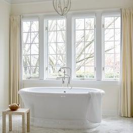 Traditional Master Bath with Herringbone Marble Floors