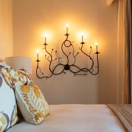 Beautiful and unique custom headboards and lighting.