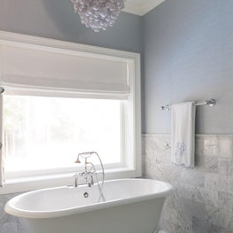 Serene Master Bath with Freestanding Tub and Marble Wainscoting