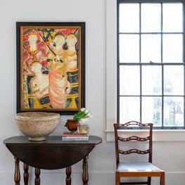 Vignette shot of vintage furnishings and original art
