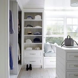 a simple master closet for a beach house