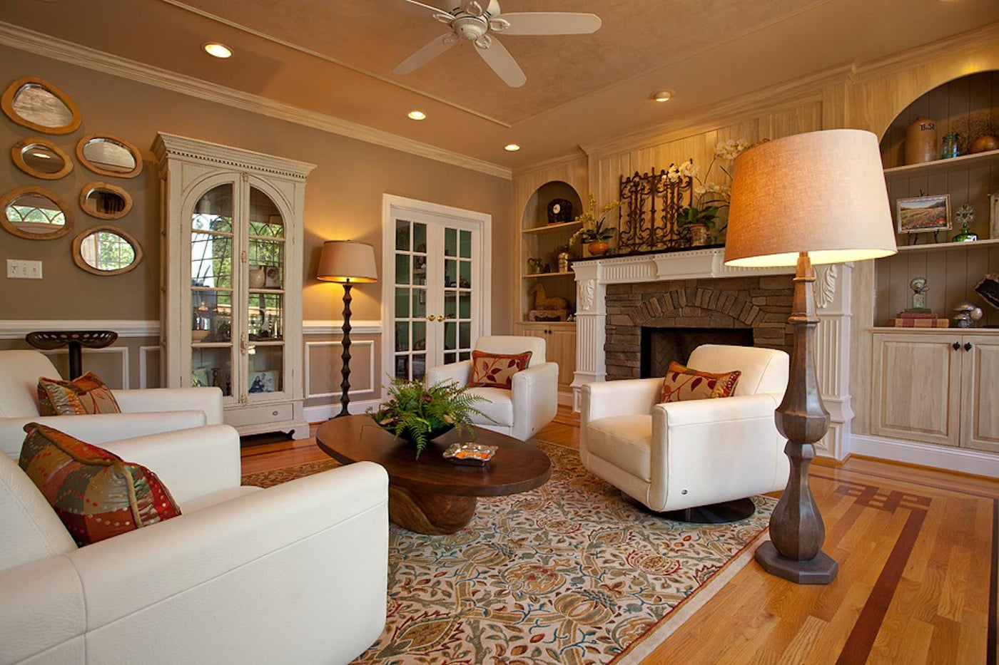 Traditional living with hand-crafted coffee table, red accents and white leather