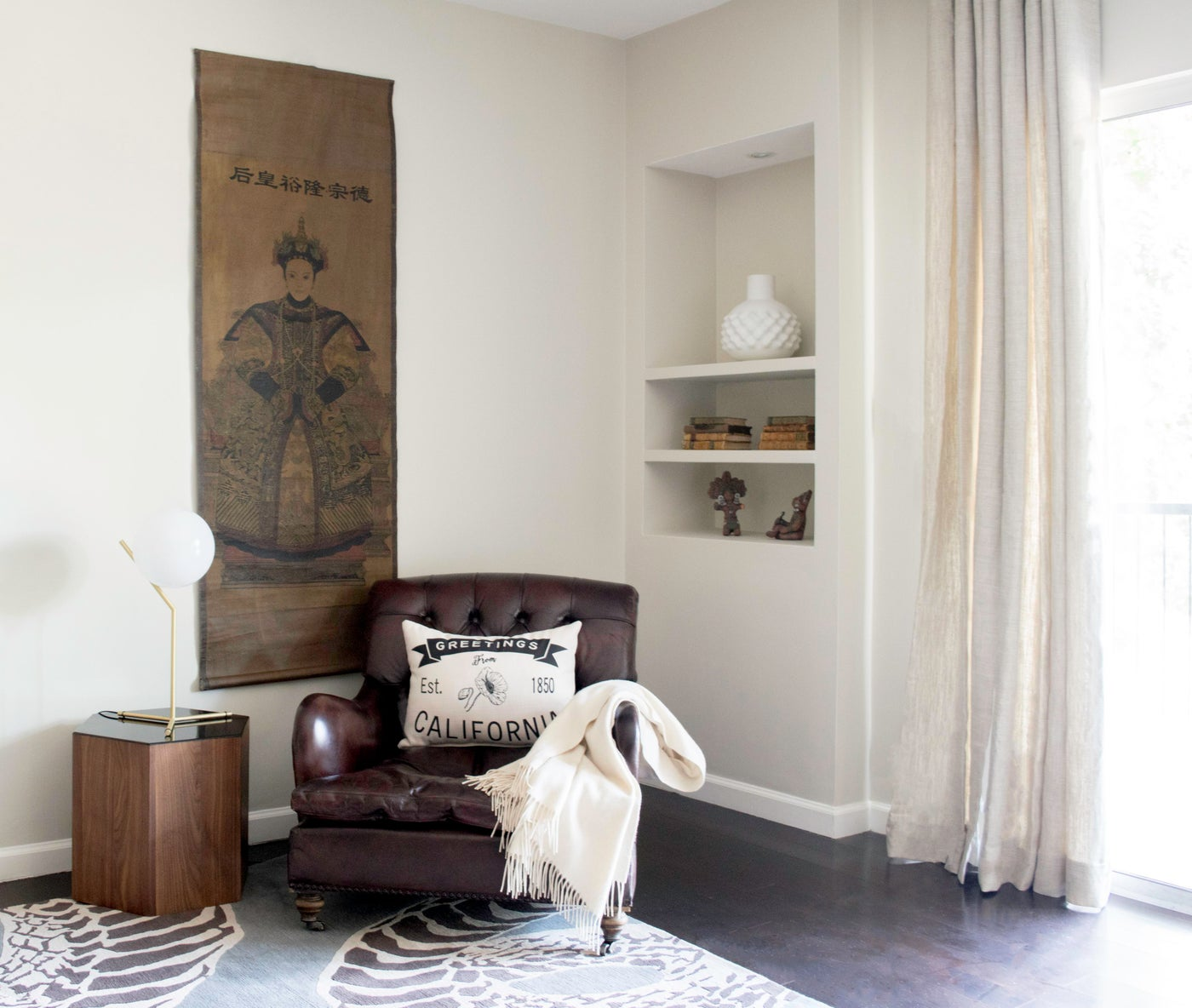 Airy, modern and minimal Hollywood den features neutral tones and vintage finds