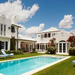 The garden and rear facade of a Bermudian Colonial house in Palm Beach