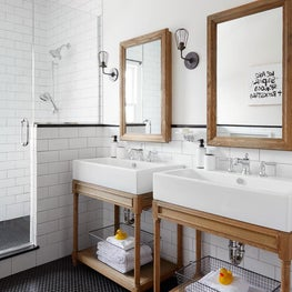 Judson Ave. Bathroom with Wood Washstands and Black Mosaic Floors