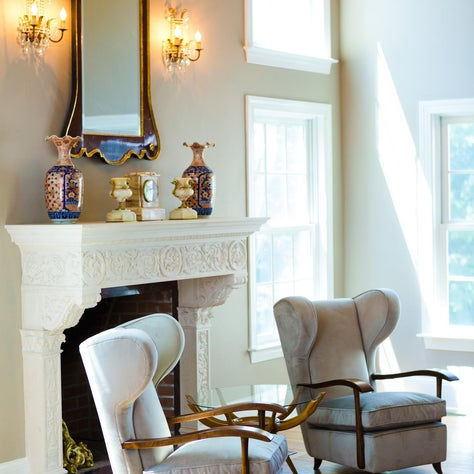 Cozy by the fireplace with some 1940 Gio Ponte chairs from my own collection and a stunning limestone Italian mantel