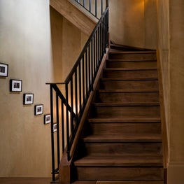 Clean-lined rusticity in a back stair in a large country retreat