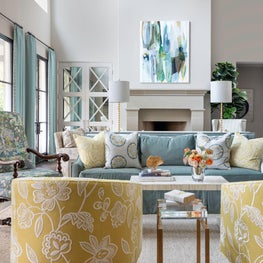 Transitional family room in a fresh color palette with floral fabric embroidery