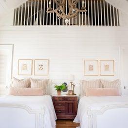 Florida beach house with loft, pink pillows & shiplap walls
