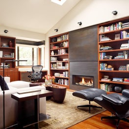Library with fireplace and hidden TV by Hyde Evans Design