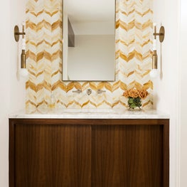 Gorgeous powder room vanity with a yellow pattern backdrop
