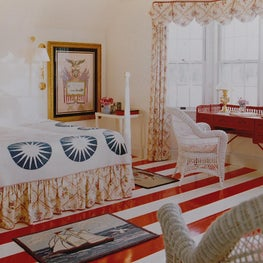 Red and White Painted Floors in Maine Summer Home