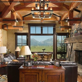Elegant wooden ceiling and iron lighting with mountain view