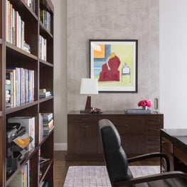 Get your work accomplished in this Home Office with custom cabinetry and custom wallpapered barn door when opened is an art wall - Los Altos Hills Residence