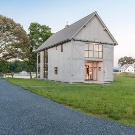 Modern barn house style, white wood rear facade