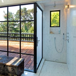 Master Shower with Steel-Framed Windows and Door to Private Deck