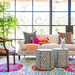 Colorful modern living room with bright rug