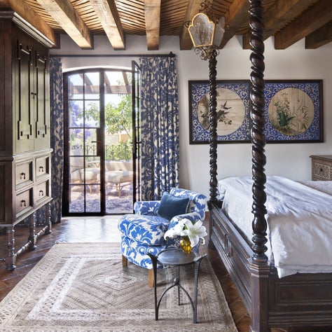 This bedroom features painted panels from a Japanese temple ceiling.