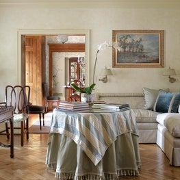 Petite living room herringbone floors,banquette,swing arm lamps,antique lamps