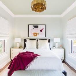 Jewel tone bedroom with gold chandelier
