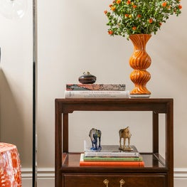 Living Room Wooden Side Table with Orange Accents in Atherton Residence II