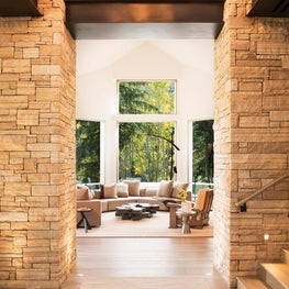 Snowmass Village, Aspen Two Creeks Remodel-Living Room with stone columns and steel