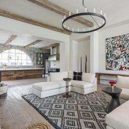 Grand family room open to kitchen with cashmere sofas; Houston, TX
