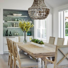 COASTAL OPEN DINING WITH STATEMENT CHANDELIER, BAR & FOLDING GLASS DOORS TO THE OUTSIDE