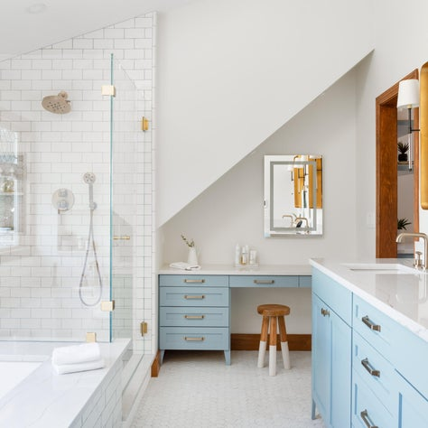 master bathroom/undermount bath/painted vanity/mixed finishes/brass/glass shower