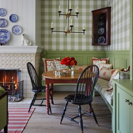 Breakfast room in chic farmhouse kitchen, green gingham wallpaper
