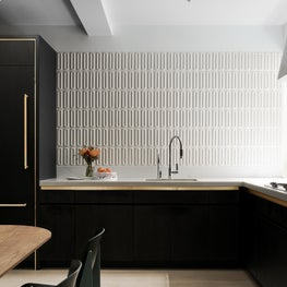 Lively three dimensional tiles and high contrast palette in a Park Ave kitchen