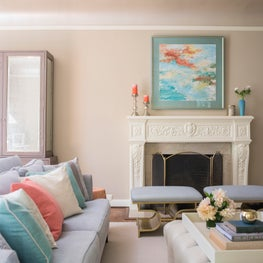 Serene Living Room with Neutral Furniture and Coral Accessories