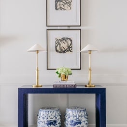 Houston Living Room Navy Parsons Table, Brass Lamps, Abstract Art, Blue & White