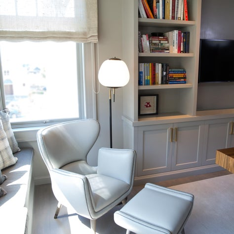 Gray home office with custom cabinetry and chair from Coup D'etat
