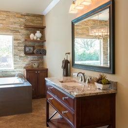 Transitional master bath with freestanding sink vanities