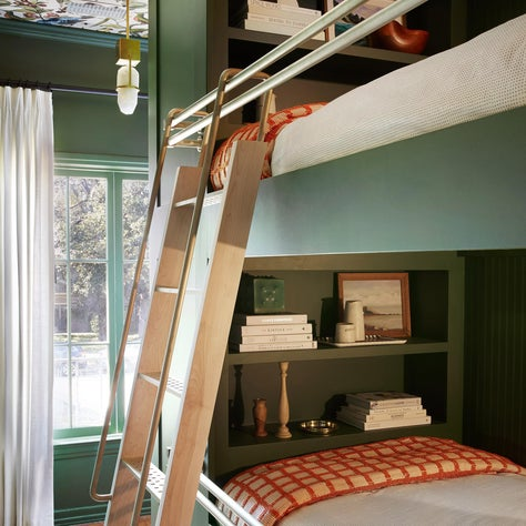 Colorful Green Bunk Room with Wallpapered Ceiling