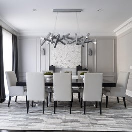 Modern Dining Room with Unique Chandelier, Cowhide Patchwork Rug