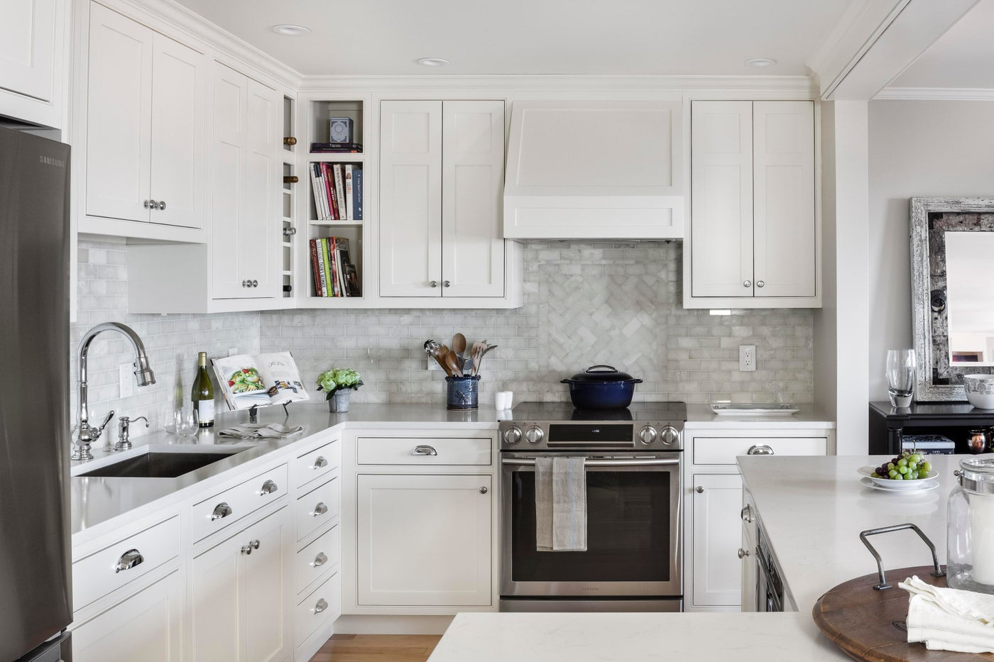 Stand-out custom kitchen cabinetry with onyx backsplash