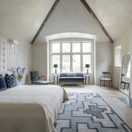 Luxury master suite with blue + white accents & wood beams; Houston, TX
