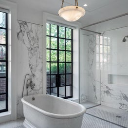 A room with a view!  A master bath with marble tub and glass shower