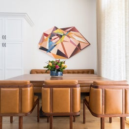 Scalar Field, a custom shaped painting by Kevin Moore, defines the dining area with bold geometry and complementary color palette.