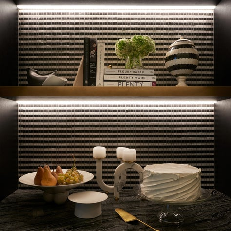 Graphic lighting and mosaic tile in a pantry niche in a Park Avenue kitchen