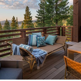 Outdoor seating on back deck at Martis Camp residence