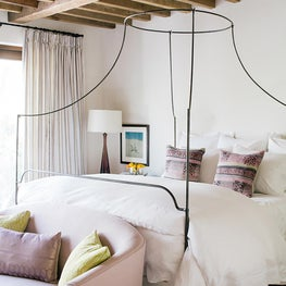 Guest Bedroom Vintage beams, Iron canopy bed, lavender,