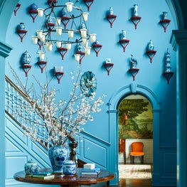 Blue foyer with wainscoting, blue and white Chinese ceramics